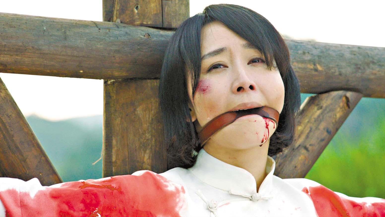 胡靜在劇中面對生死時仍能淡然一笑,在受 刑後死亡。 網上圖片