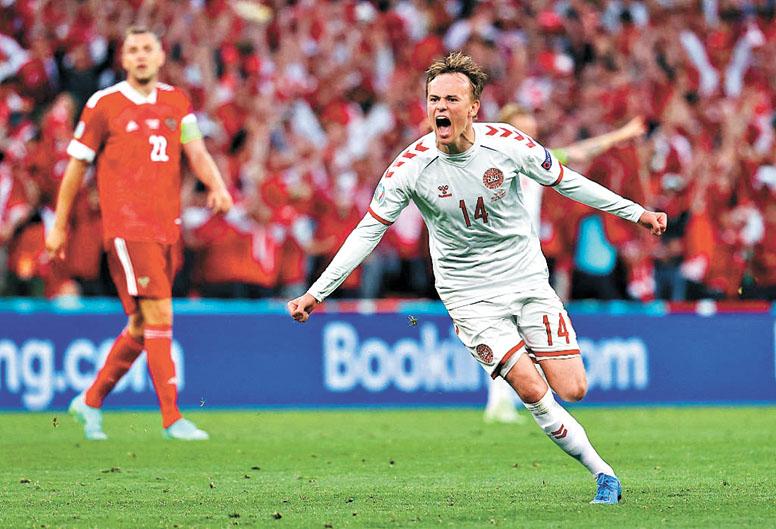 丹麥隊逆境爆發。圖為達姆斯加德轟世界波怒吼慶祝。網上圖片