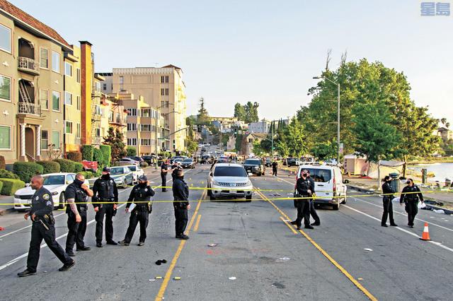 6月19日警方調查美麗湖附近槍擊案現場。美聯社資料圖片